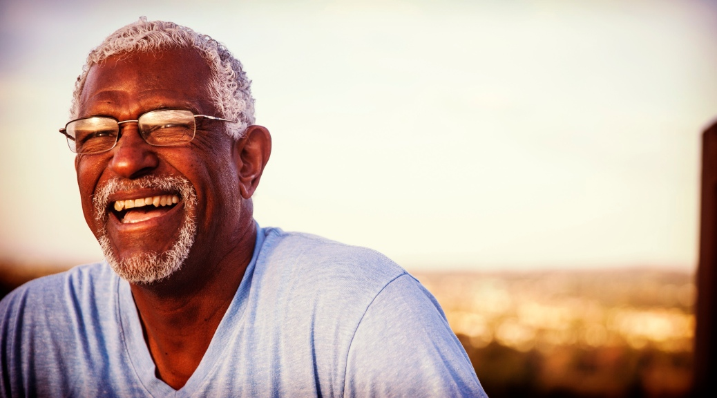 Smiling man in t-shirt, glasses